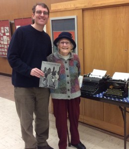 Jean Bates Pratt 1939 graduate holding a copy of a 1939 Gibbsonian. Michael Winer, editor of the Weston newspaper, is with her.